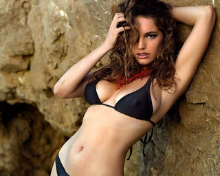 Photo famous corpulent Model Kelly Brook poses for glossy magazine authoritative .